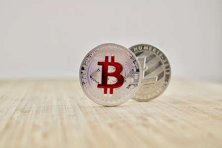 Digital currency physical silver bitcoin coin and Litecoin. Business concept.