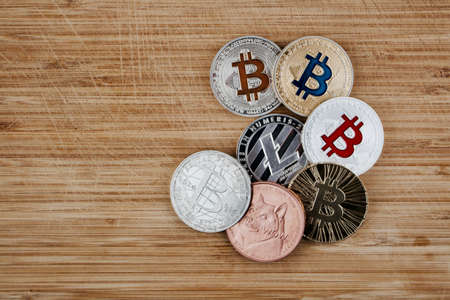 Digital currency physical gold and silver coins. Bitcoin, Dogecoin, Litecoin.