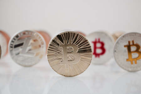 Digital currency physical gold bitcoin coin near silver Litecoin.