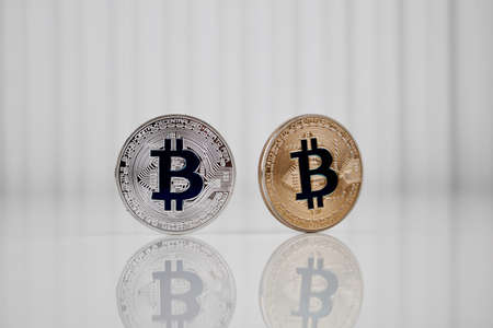 Digital currency physical silver and gold bitcoin coin. Фото со стока