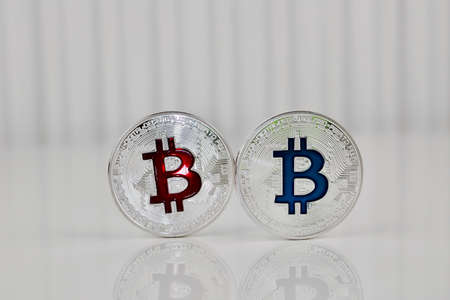 Digital currency physical silver bitcoin coin red and blue scene.