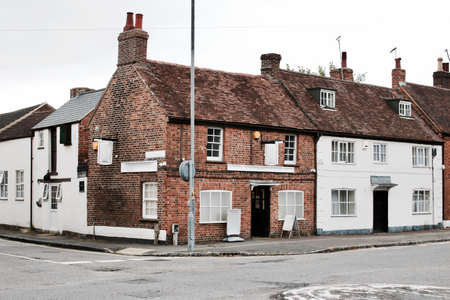 Two old buildings near the road in Newport Pagnell Town Centre. Buckinghamshire. Editorial