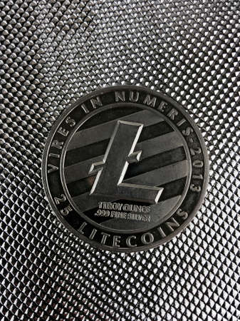 Digital currency physical silver litecoin coin on the silver background