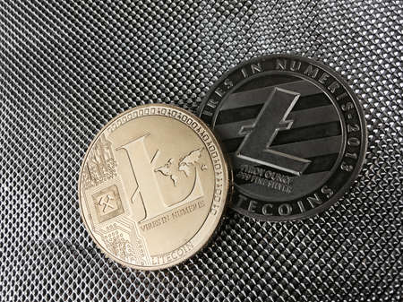Digital currency physical gold litecoin coin and silver litecoin.