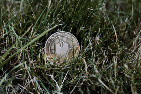 Digital currency physical metal bitcoin coin. Virtual money concept.
