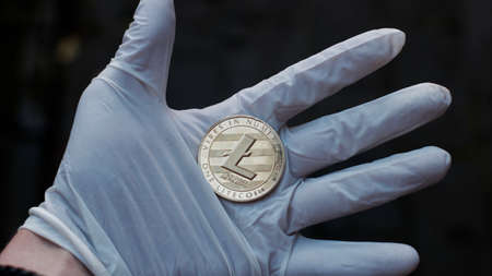 Digital currency physical metal litecoin coin. Virtual cash concept.