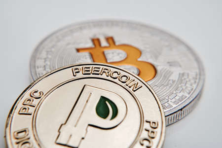 Digital currency physical metal bitcoin coin. Virtual cash concept.