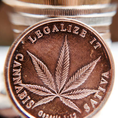 legalize: Brass marijuana coin with cannabis leaf. Legalize it. Sativa.