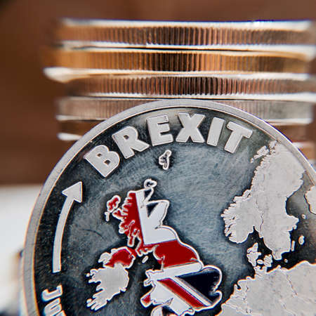 Europe leaving. Brexit coin with british map. Article 50. Union.