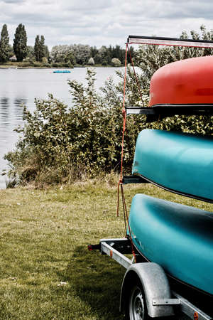 Blue and red kayak on the trailer near lake in Milton Keynes. Bedfordshire.