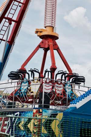 Colorful carousel in amusement park. Sunny sunday in Milton Keynes.