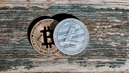 Digital currency physical gold red bitcoin coin. Outdoor money concept.