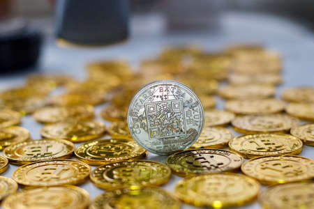 Digital currency physical metal bitcoin coin on the gold bitcoins. Gold money concept. Stock Photo