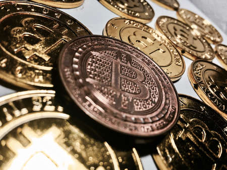 Digital currency physical metal bitcoin coin on the gold bitcoins. Cryptocurrency concept. Stock Photo