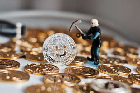 Cryptocurrency physical metal bitcoin coin. Digital currency virtual money concept. Zdjęcie Seryjne