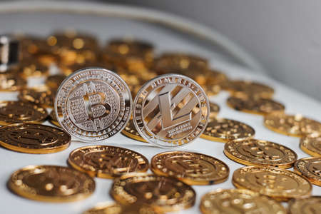 Cryptocurrency physical metal bitcoin coin. Digital currency virtual money concept. Фото со стока