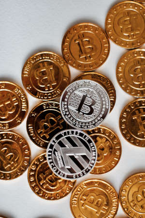 Cryptocurrency physical metal bitcoin coin. Digital currency virtual money concept. Stock Photo