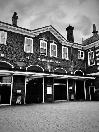 Train station in Clapham Junction, London. Old brick buildings. Architecture. Black and white photography.