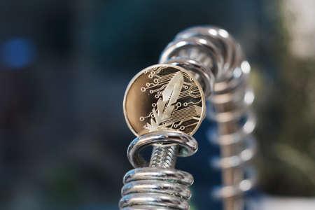 Gold feather coin Zdjęcie Seryjne