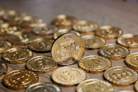 peer to peer: Digital currency physical metal bitcoin coin on the gold money background. Money concept.