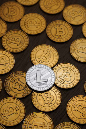 Digital currency physical metal litecoin coin. Cryptocurrency miningn concept.