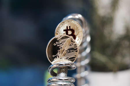 peer to peer: Digital currency physical metal bitcoin coin. Cryptocurrency cash concept.