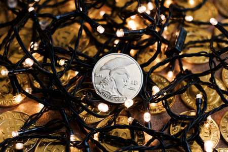 peer to peer: Digital currency physical metal bitcoin coin on the christmas concept.