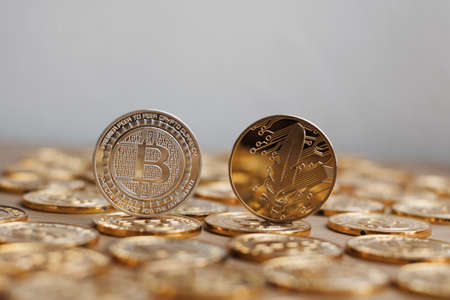 Digital currency physical bitcoin coin. Gold background coins concept. Stock Photo