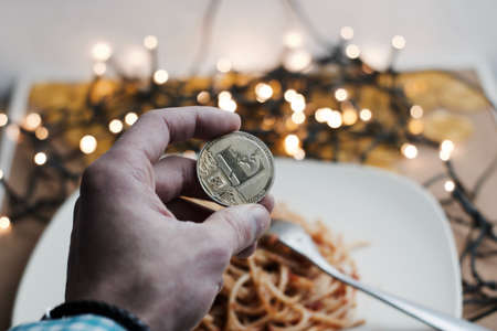 Digital currency physical metal gold litecoin coin. Italian food concept.