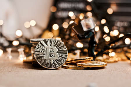 Digital currency physical metal coin. Christmas cryptocurrency concept. Stock Photo