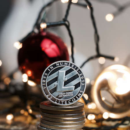 Digital currency physical silver metal litecoin coin. Christmas concept.