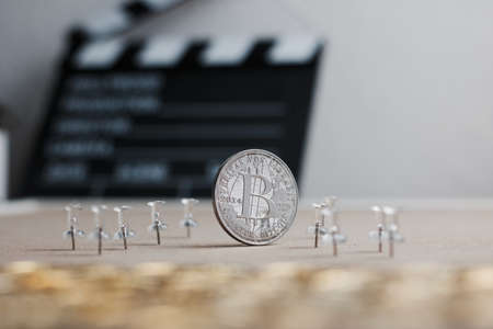 Digital currency physical metal bitcoin coin. Cryptocurrency cinema concept.