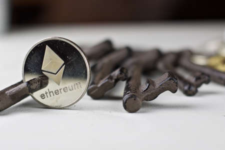 Digital currency physical ethereum coin. Cryptocurrency concept. Stock Photo