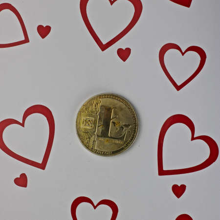 Digital currency physical metal litecoin coin. Love scene background.