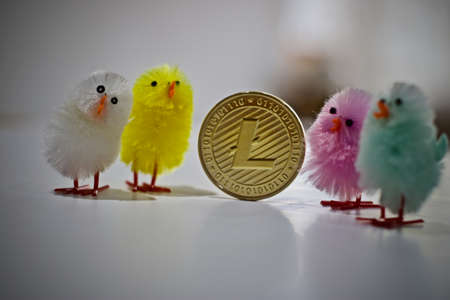 Digital currency physical metal litecoin coin. Easter cryptocurrency concept. Stock Photo