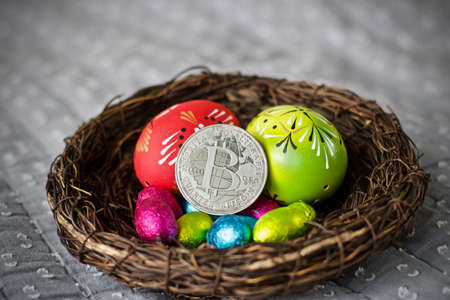 Digital currency physical metal bitcoin coin. Cryptocurrency easter concept. Stock Photo