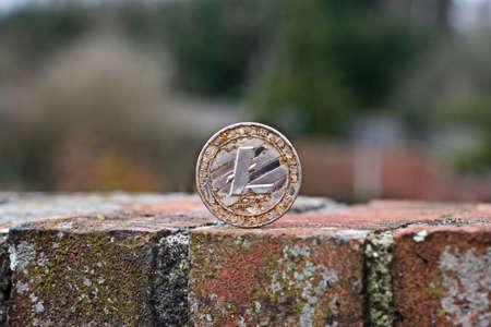 Digital currency physical metal litecoin coin. Cryptocurrency outdoor concept.