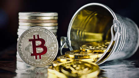 Digital currency physical metal bitcoin coin. Cryptocurrency gold concept. Stock Photo