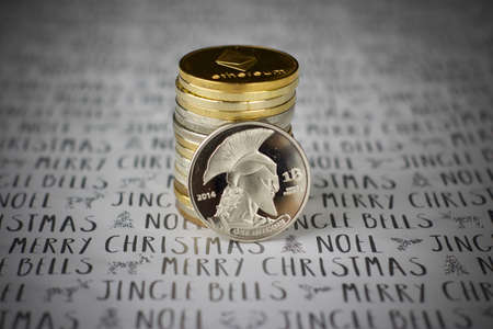 Digital currency physical metal bitcoin coin in christmas concept. White and grey background.