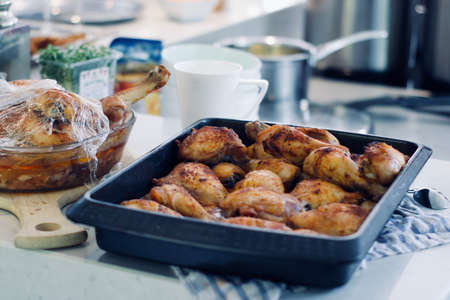 Tasty and fresh chicken wings in the kitchen. Party food concept.