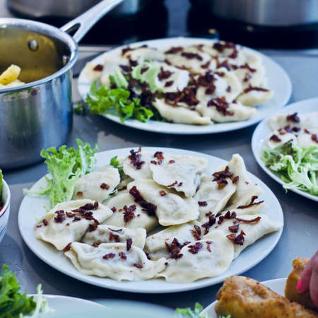 Fresh and delicious polish dumplings in the kitchen. Food concept. Stock Photo