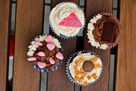 Tasty and fresh cupcakes on the wooden table. Sweet food concept.