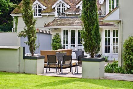 Green garden near the house. Summer concept. England. Editorial