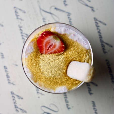 Dessert tapioca with coconut milk, strawberry and sugar.