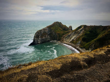 Durdle Door Beach with fantastic rock & cliffs. Nature on the beach. Dorset, England. Stock Photo