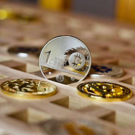 Digital currency physical metal bitcoin coin. Cryptocurrency business concept.