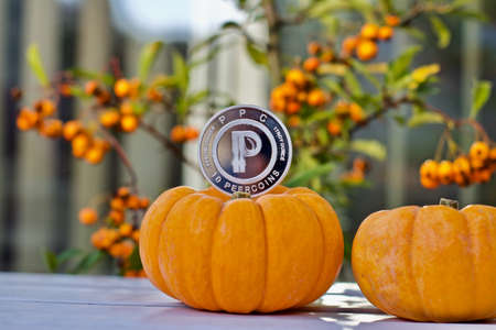 Digital currency physical metal silver peercoin coin. Halloween concept. Stock Photo