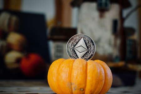 Digital currency physical metal ethereum coin. Halloween cryptocurrency concept.