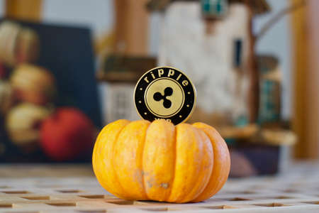 Digital currency physical metal ripple coin. Cryptocurrency halloween concept.
