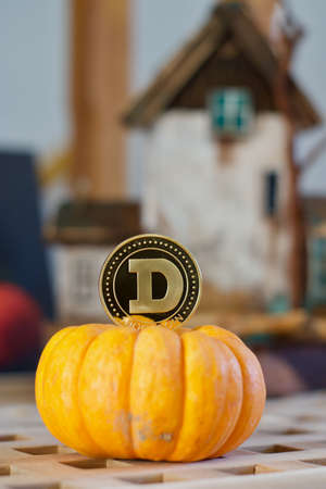 Digital currency physical metal gold dogecoin coin. Cryptocurrency halloween concept.